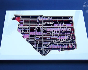 Intricate, shimmering, laser cut map of Northcote, Victoria with red fabric infused acrylic.