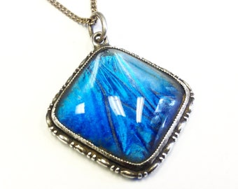 Blue Morpho butterfly wing pendant necklace, 1920s.