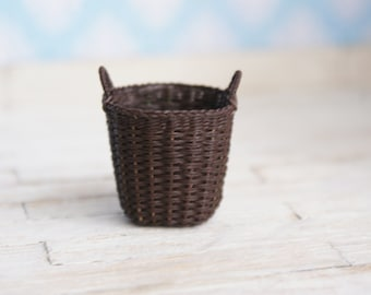 A miniature dark brown basket