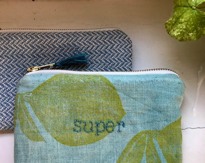 "Embroidered ""super"" clutch"