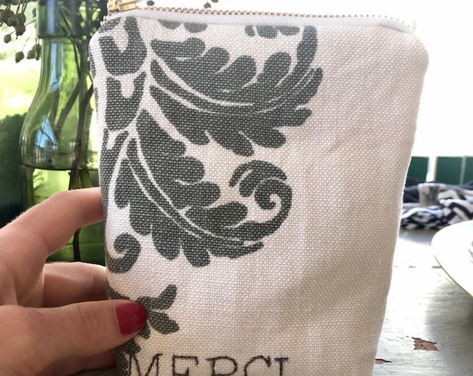 "Embroidered ""MERCI"" clutch"