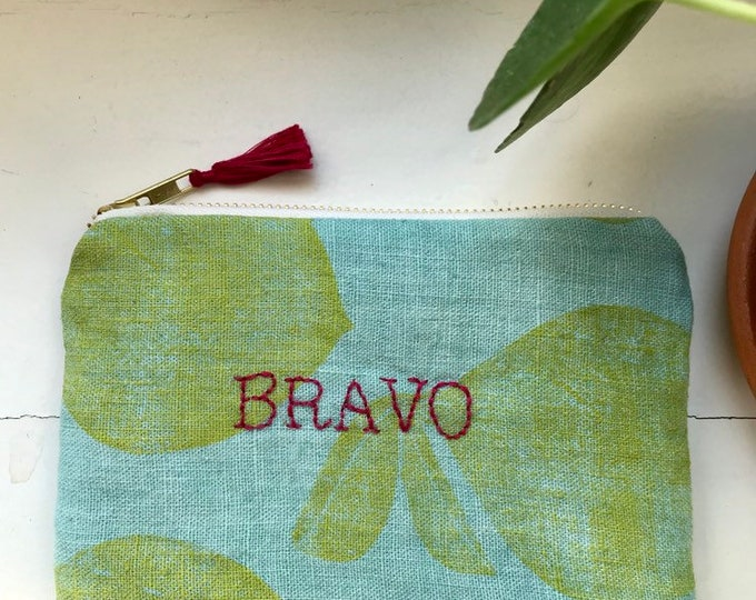 "Embroidered ""Bravo"" clutch"