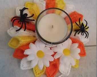 orange, yellow candle holder