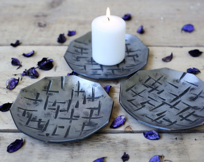 Set of 3 contemporary polished iron candle dishes