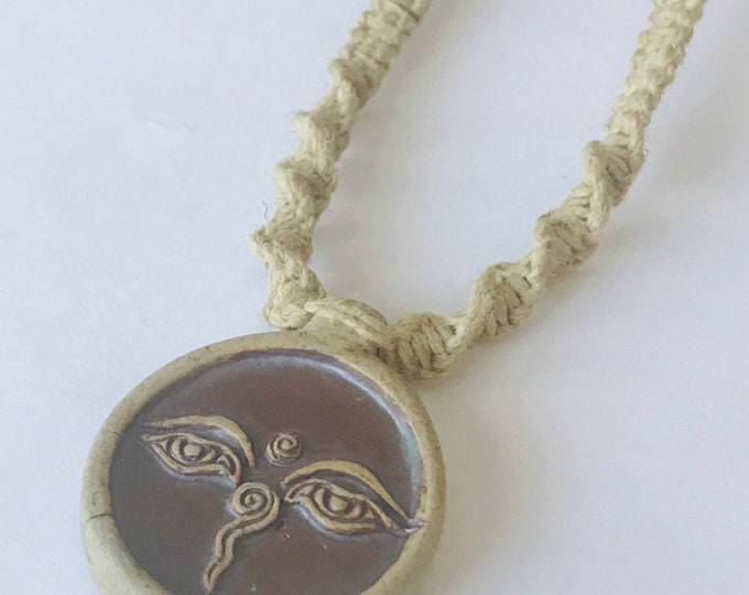 Handmade Hemp Necklace with High Fired Buddha Eyes Ceramic Peruvian Pendant