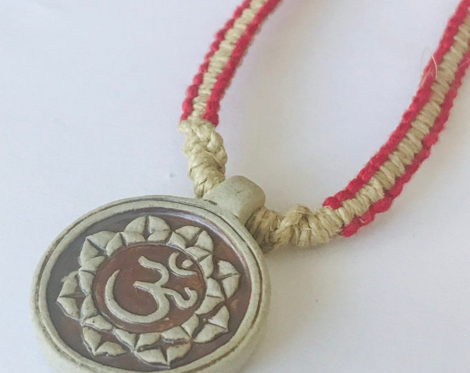 High Fired Ohm Pendant on Handmade Hemp Necklace