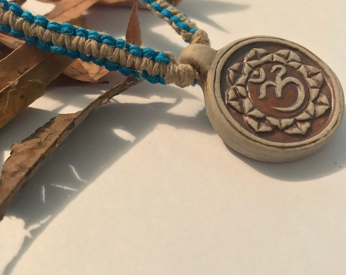 Handmade Hemp Necklace with High Fired Ohm and Lotus Peruvian Bead Pendant Blue