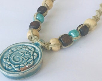 Handmade Hemp Necklace with Raku Peruvian Lotus and Ohm Pendant