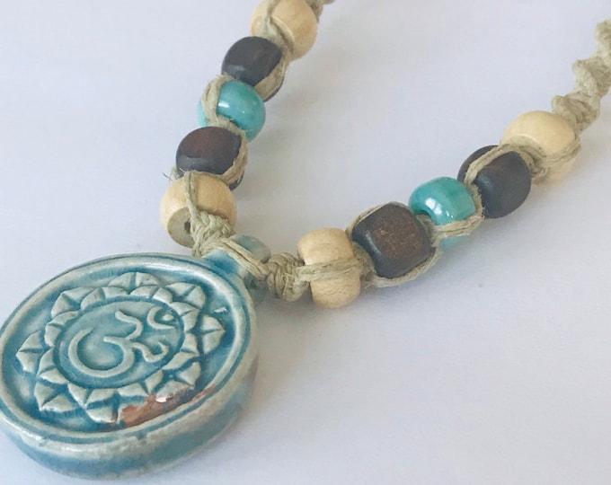 Handmade Hemp Necklace with Raku Peruvian Lotus and Ohm Pendant