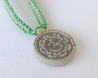 High Fired Ohm Raku Pendant on Handmade Hemp Necklace