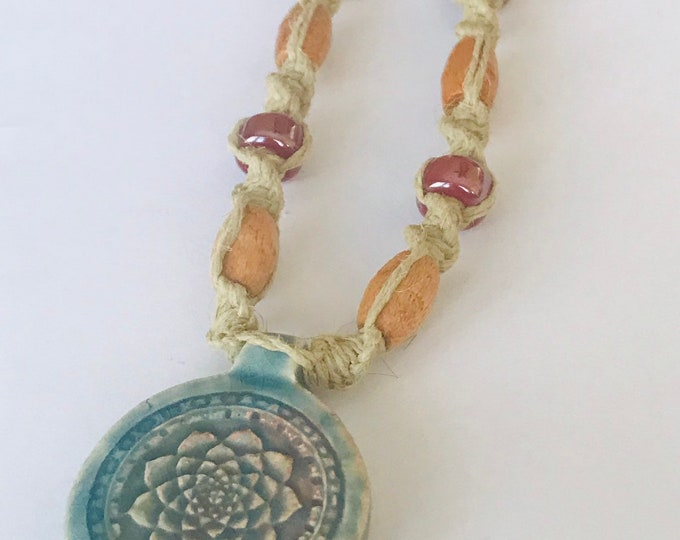 Peruvian Raku Lotus Pendant on a Handmade Hemp Necklace