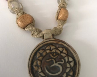Handmade Hemp Necklace With High Fired Raku Ohm Lotus Pendant