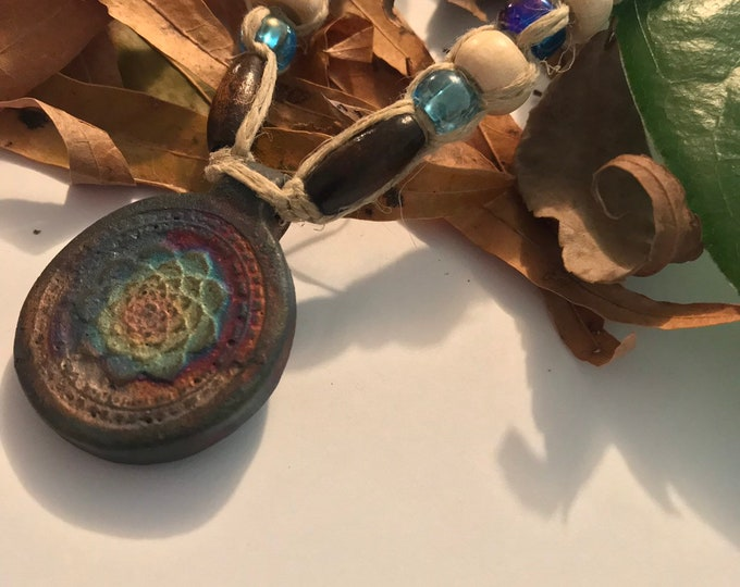 Matte Raku Lotus Rainbow Pendant on Handmade Hemp Necklace