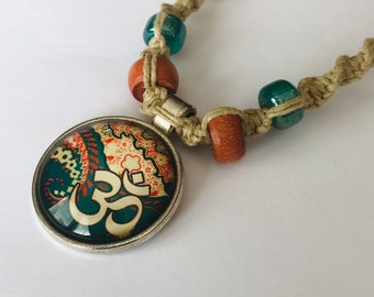 Handmade Hemp Necklace with Cabochon Ohm Pendant