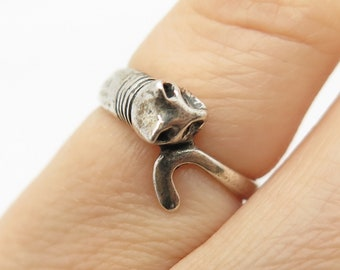 cat Marked on the interior Vintage sterling silver ring of a leopard biting its own tail Size 6.5 Statement ring
