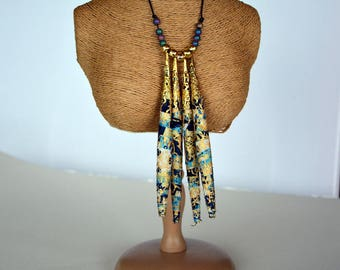 Bib necklace made of light blue and dark blue fabric