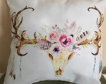 Decorative cow skull pillow with floweres