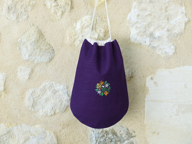 Purple pouch embroidered lined in cotton closure cords image 0