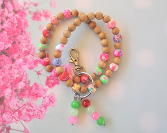 Multi Color Polymer Clay Beads With A Gemstone Cross Key Chain Bracelet Grey