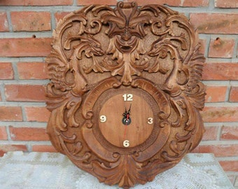 Wooden clock dragons.  Carved entirely by hand.