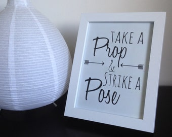 Take a Prop and Strike a Pose Sign