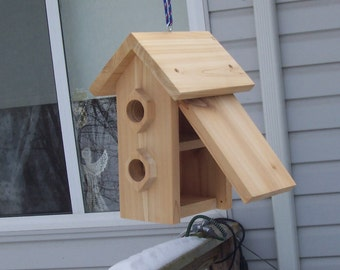 Handmade duel nests hanging birdhouse with extra thick fronts.