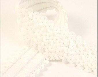 10 Meter card of glossy white elastic sequin trim. 32mm - 1.25 inch width. Code JR03310