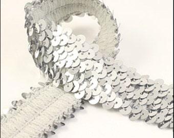 10 Meter card of shiny silver elastic sequin trim. 32mm - 1.25 inch width. Code JR03317