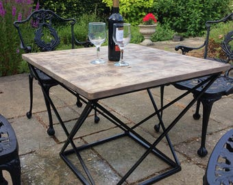 Multi use table, reclaimed wooden top. Heavy steel frame.