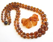 Amber Barrel Beaded Double Row Vintage 28 quot Long Necklace and Plastic Amber Large Floral Bow 3 1 8 quot Wide Brooch - Estate Jewelry