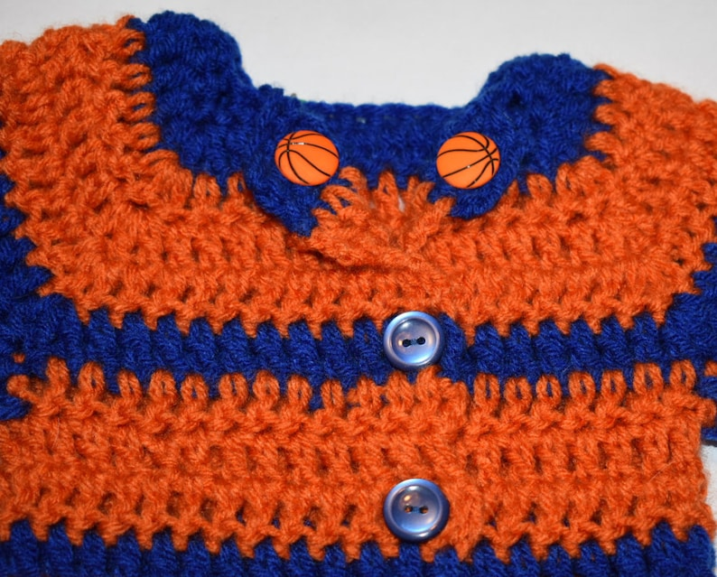 Newborn to 3m Orange and Blue crochet long-sleeve sweater; wbasketball accent buttons