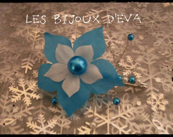 clip holder behind turquoise and white silk flower