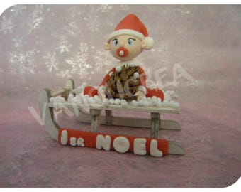 baby porcelain cold Christmas on a sled