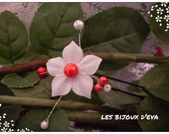A hair stick with white silk flower pearls