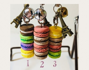 Macaron charms. 1 for 8 dollar, 2 for 15, 3 for 18. A strap with 4 polymer clay miniature macaroons with a bell and an Eiffel tower charm.