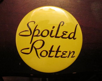this is a 70s saying Spoiled rotten  pin back button