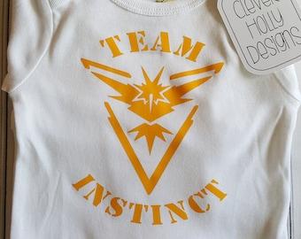 7993fd4e Pokemon Go Baby Onesie Team Instinct (also available Team Valor, Team  Mystic) (short or long sleeve baby bodysuit) [Pokemon Baby Gift Idea]