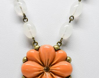 Lovely gold tone and plastic necklace