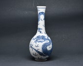 Chinese blue and white porcelain dragon vase , 8 inches, mid 20th century