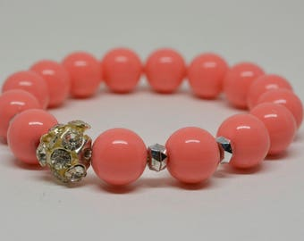 Lovely plastic pink stretchable bracelet