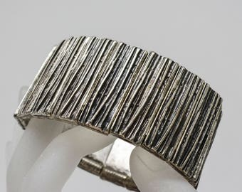 Large silver tone stretchable bracelet