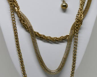 Gold tone multi strand chain necklace