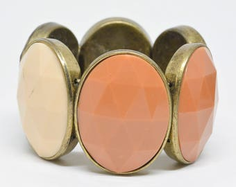 Large gold tone and plastic stretchable bracelet