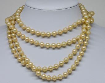 Charming gold tone faux pearl necklace
