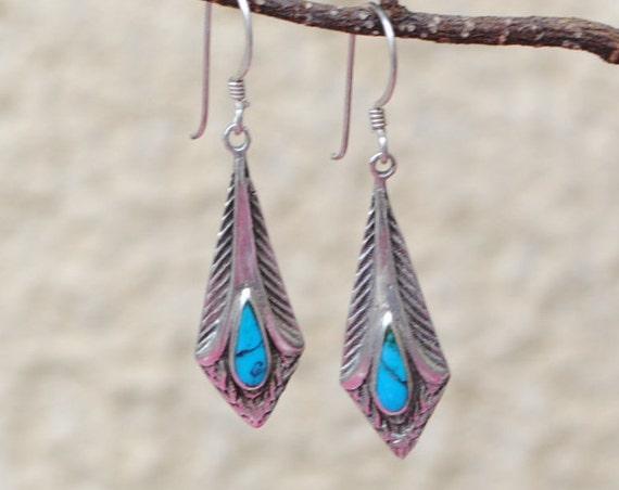 Boucles d'oreille plume en turquoise et argent
