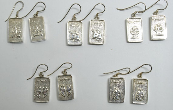 Earrings with Astrological sign set on sterling silver