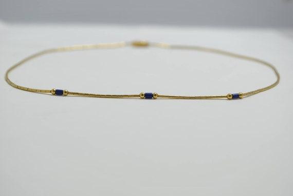 Collier en lapis lazuli et métal doré 24K