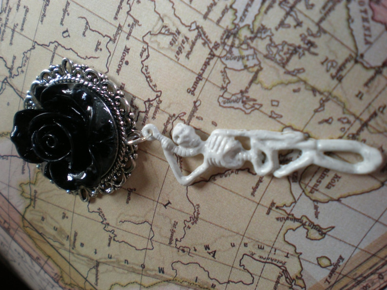 Gothic pastel goth black roses and white skeleton dangle plugs gauges earrings.