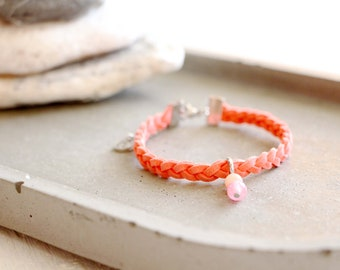 Bracelet Tripoli, braided coral suede bracelet, peach and pink bead charm, stainless steel, travel inspiration, for women