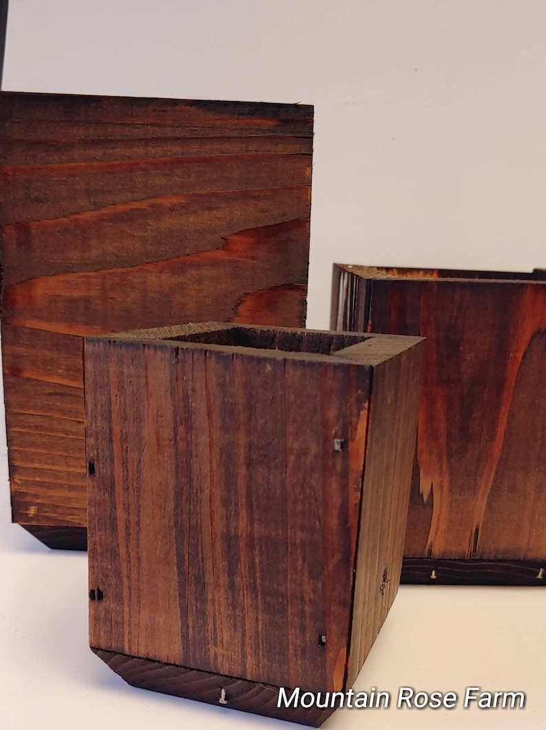 Wood planter box cedar box with stunning walnut finish hand crafted made at Mountain rose urban farm makes a great gift.